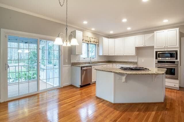 shiny hardwood floors in kitchen area