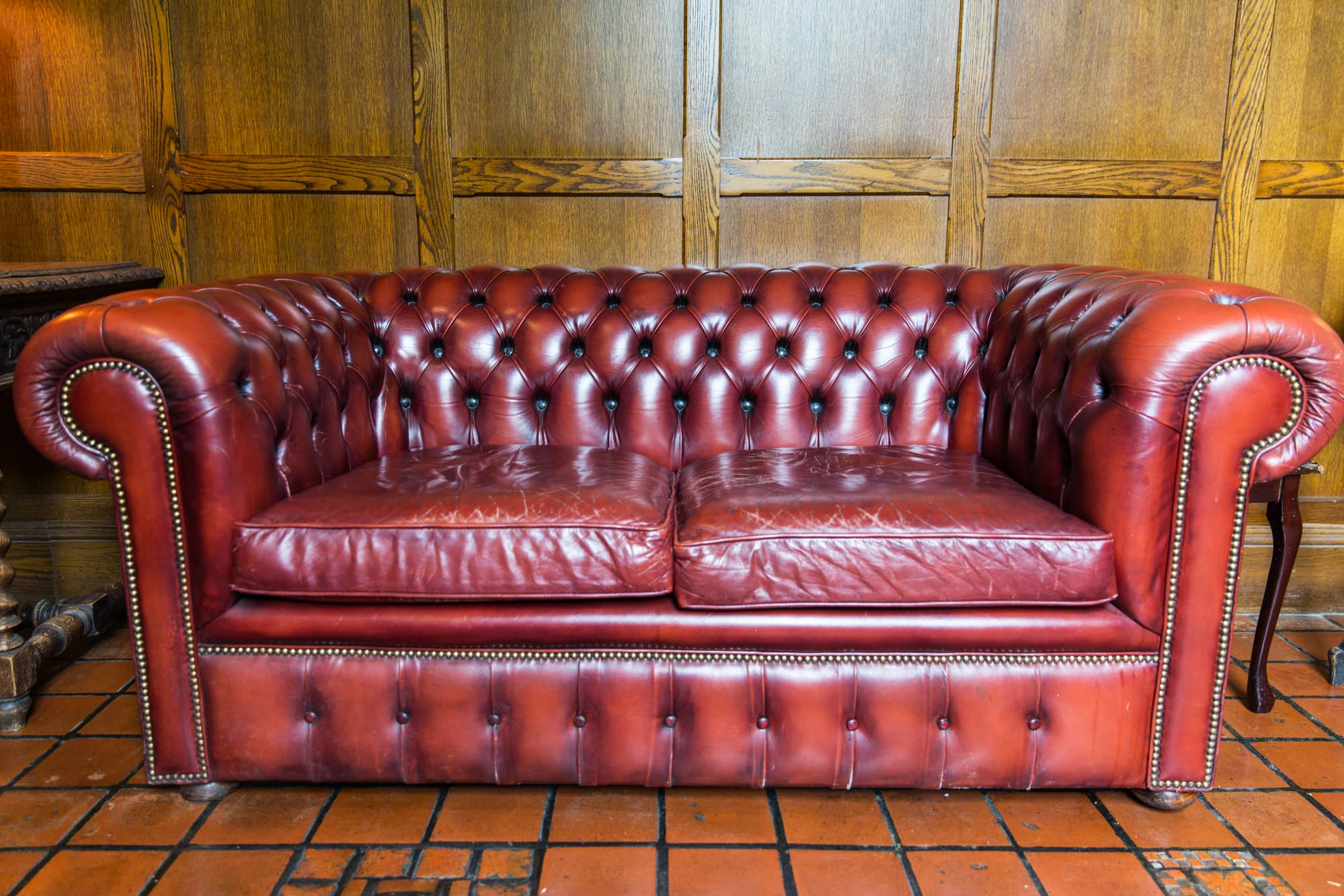 red leather couch that need restoration
